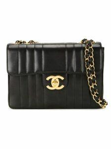 Chanel Pre-Owned stripe quilted shoulder bag - Black