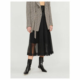 Pleated mesh and shell skirt