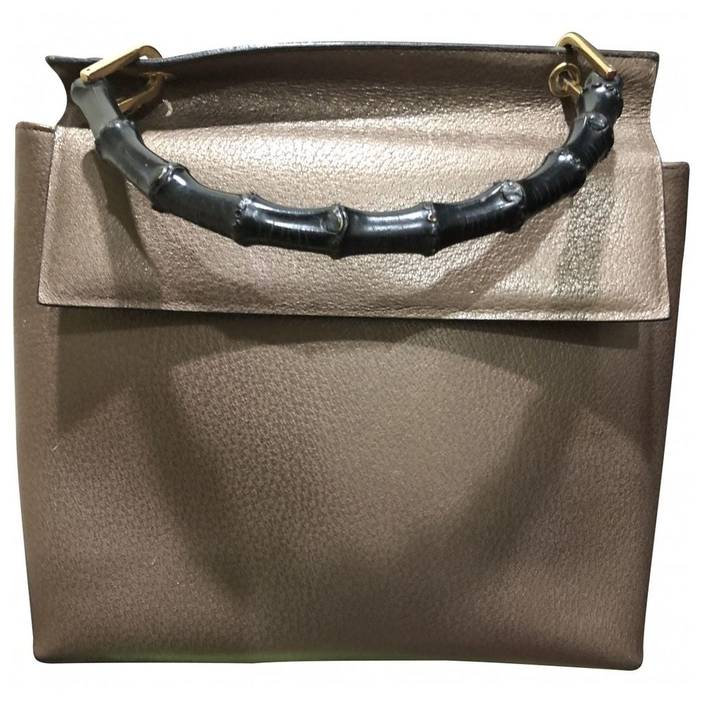 Bamboo patent leather handbag