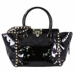 Rockstud patent leather handbag