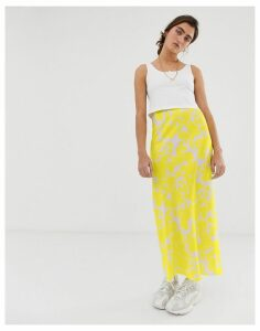 ASOS DESIGN bias cut satin slip midi skirt in bright floral
