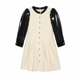 Houndstooth tweed dress with vinyl sleeves