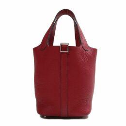 Picotin patent leather handbag